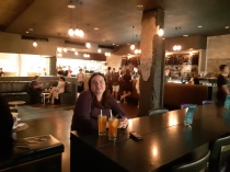Karen near the bar waiting for our food. Copyright Lloyd Marken.