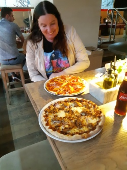Pizza after the movie at Vapianos. I got bbq chicken but Karen got a spicy meatball. Copyright Lloyd Marken.