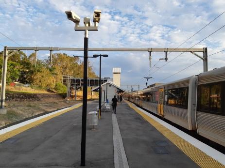 Getting off the train at Newmarket in sunny Brisbane, Australia. Copyright Lloyd Marken.