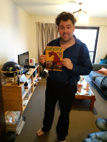 Me with a copy of Frooty Issue 10 working from home on the 31st of March, 2020. Copyright Lloyd Marken.