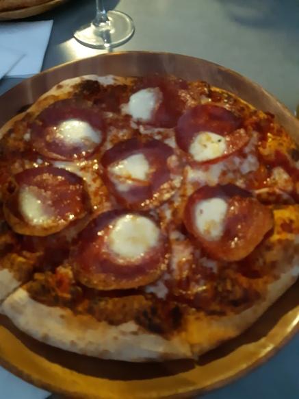 My pepperoni pizza. A friend enjoyed a Italian sausage one. Copyright Lloyd Marken.