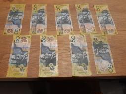 The cash on its way to the cash till at Stellarossa Toowong. Copyright Lloyd Marken.