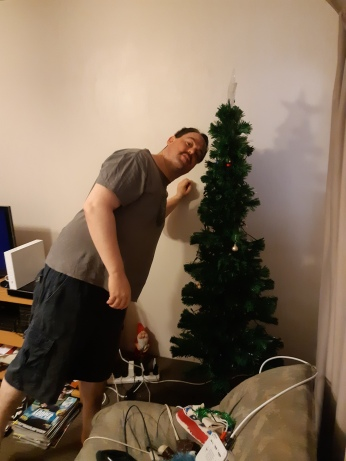 Me putting up the decorations for the first time. Copyright Lloyd Marken.